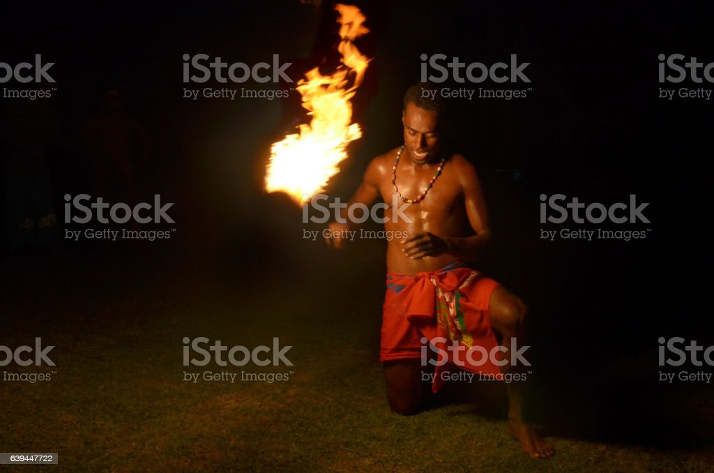 Indigenous Fijian man holds torch during a fire dance stock photo