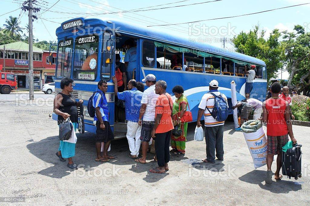 Indigenous Fijian people travel by bus in Fiji stock photo