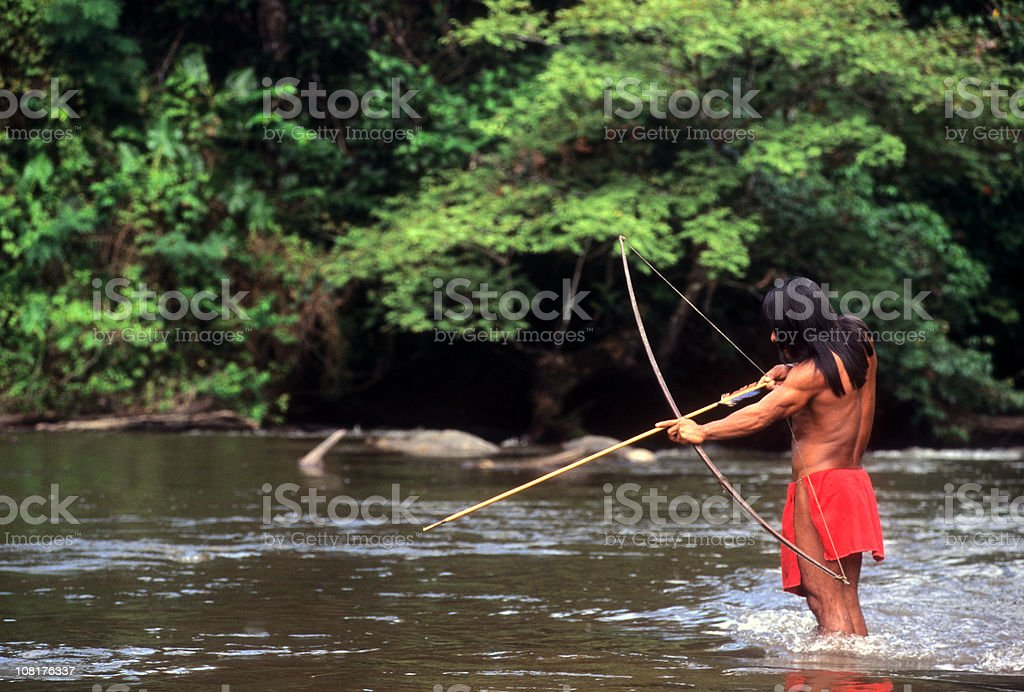 Indigenous Man Hunting in Amazon royalty-free stock photo