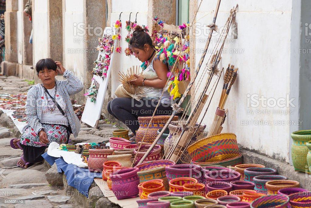Indigenous woman handcraft stock photo