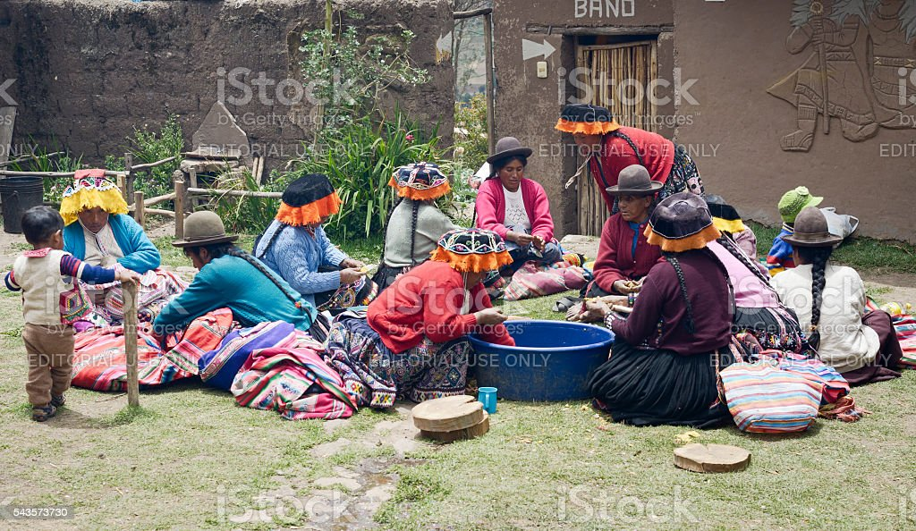 Indigenous women cutting potatoes for a local wedding ceremony stock photo