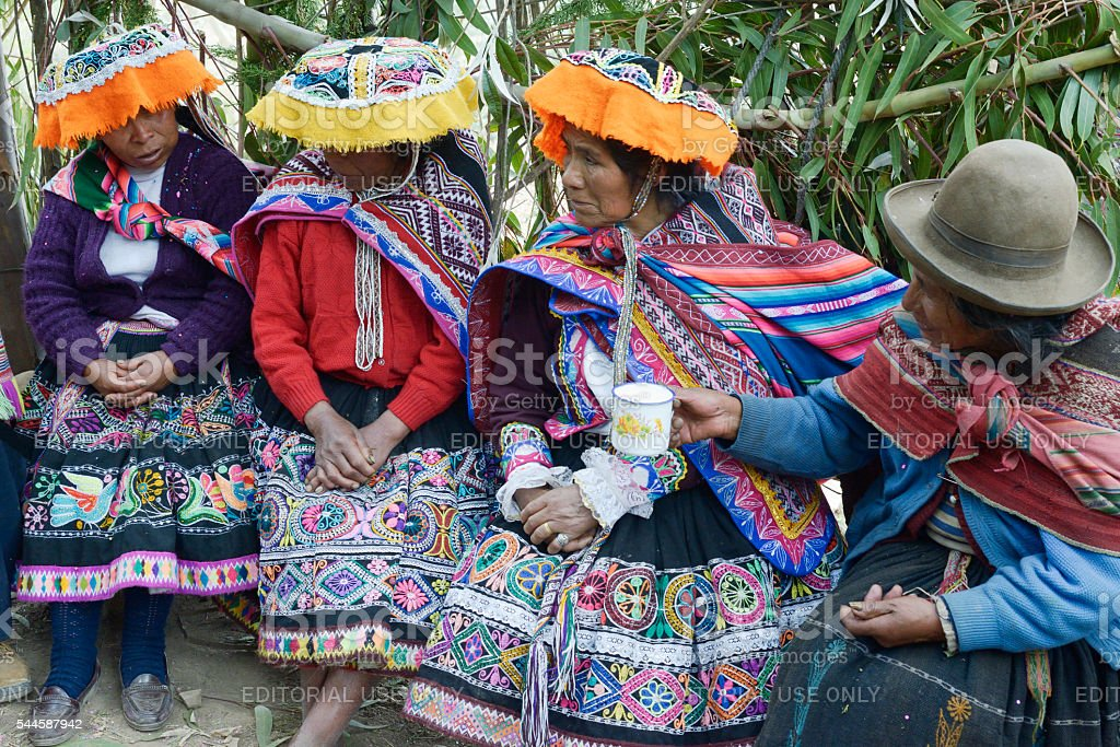 Indigenous women wearing handwoven skirts and ponchos stock photo