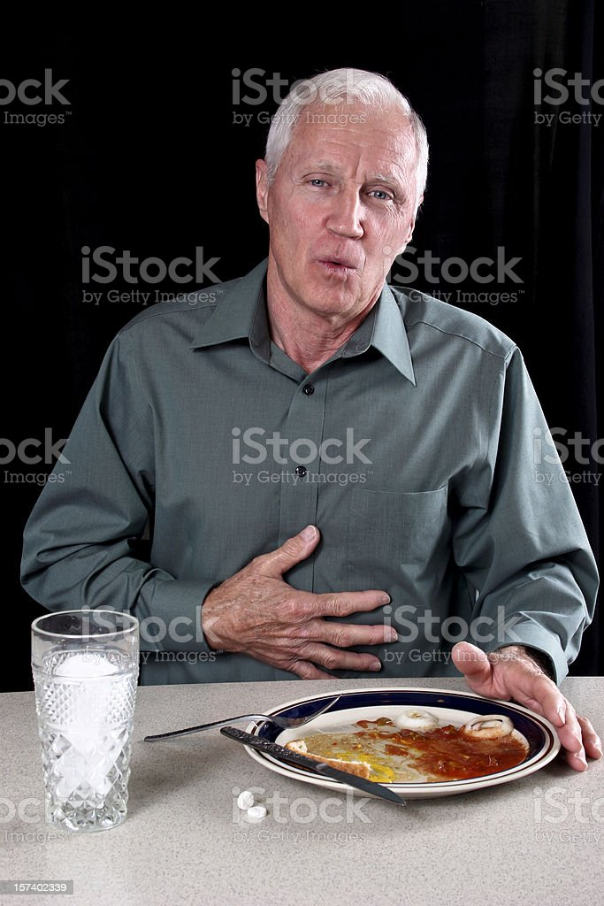 Indigestion after a meal. stock photo