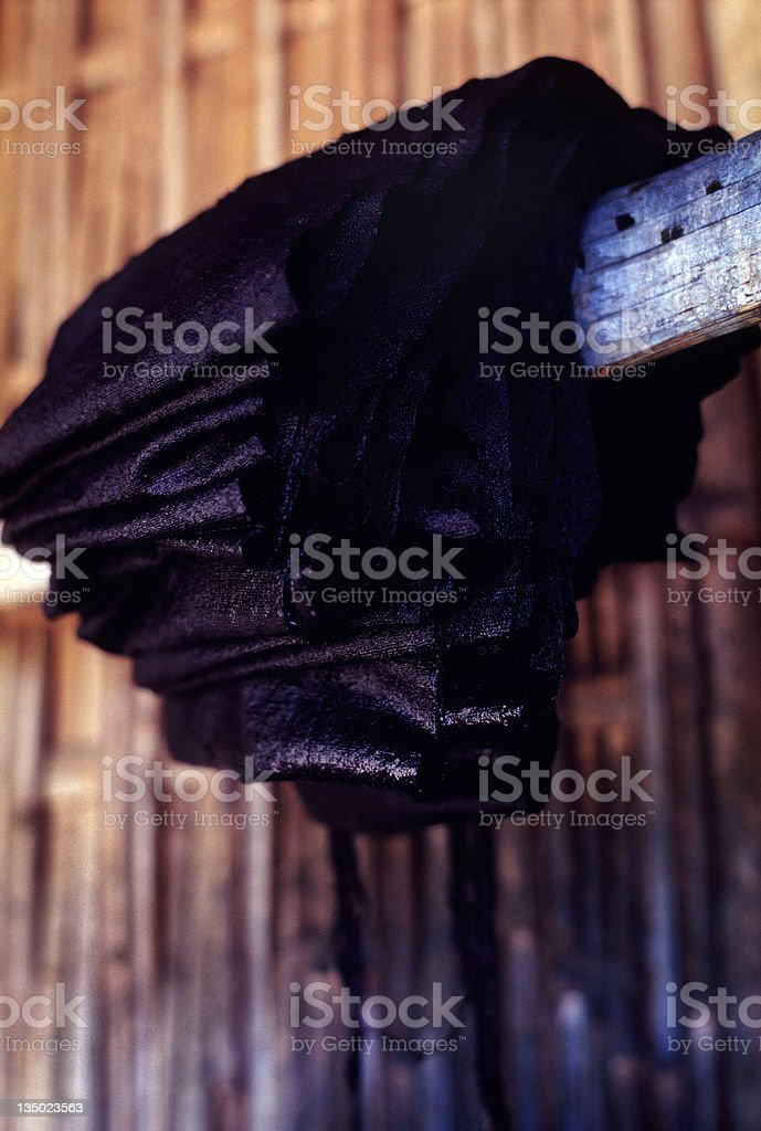 Indigo Dyed Hemp Cloth Hanging on Wooden Beam royalty-free stock photo