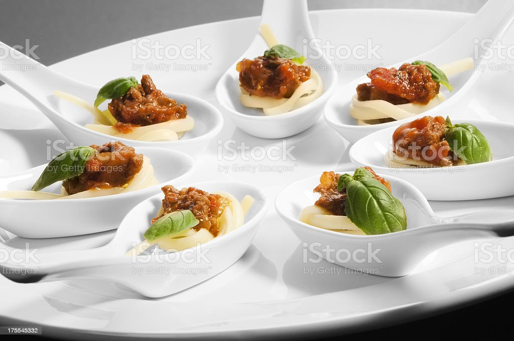 Individual canape spoons on a white serving plate royalty-free stock photo