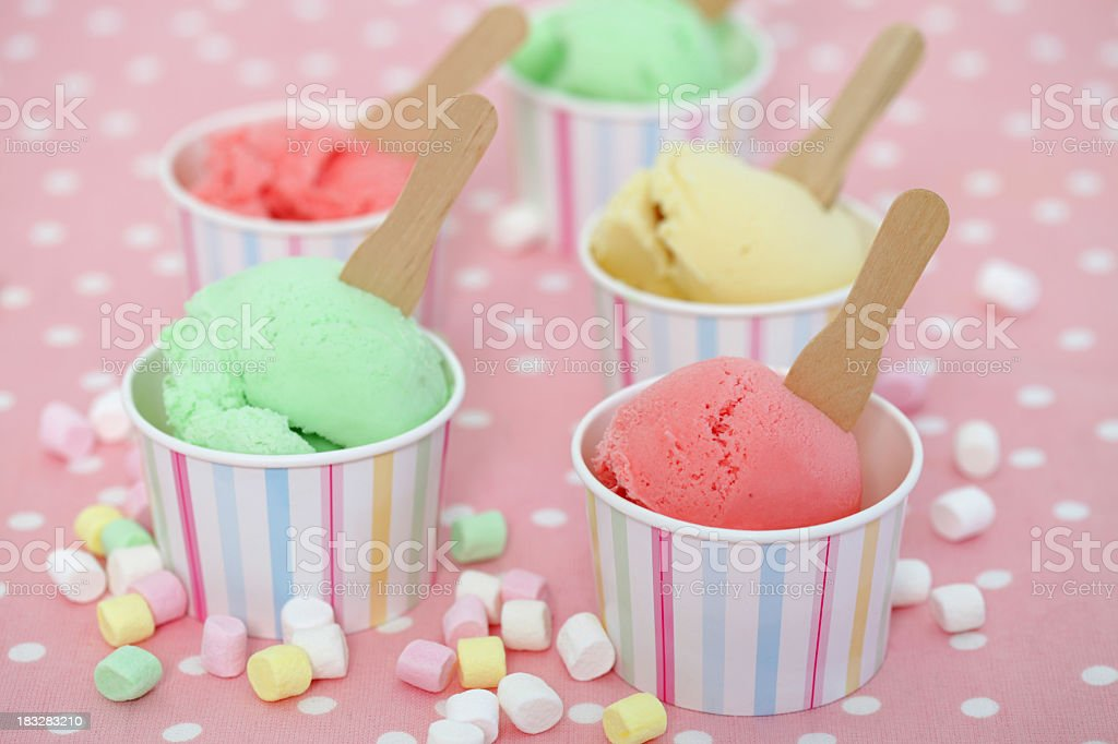 Individual cups of different flavors of Gelato royalty-free stock photo