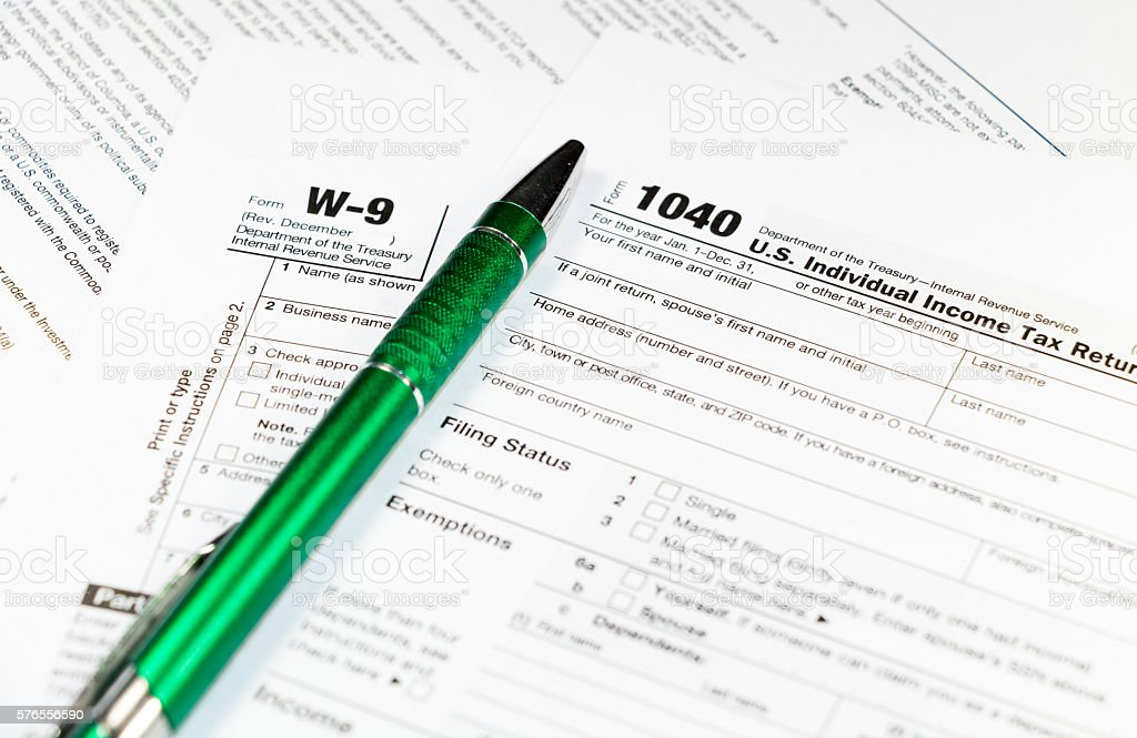 1040/W-9 Individual Income Tax Return Form with a pen stock photo
