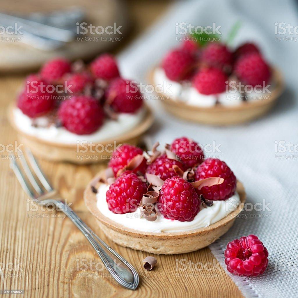 Individual raspberry tarts stock photo