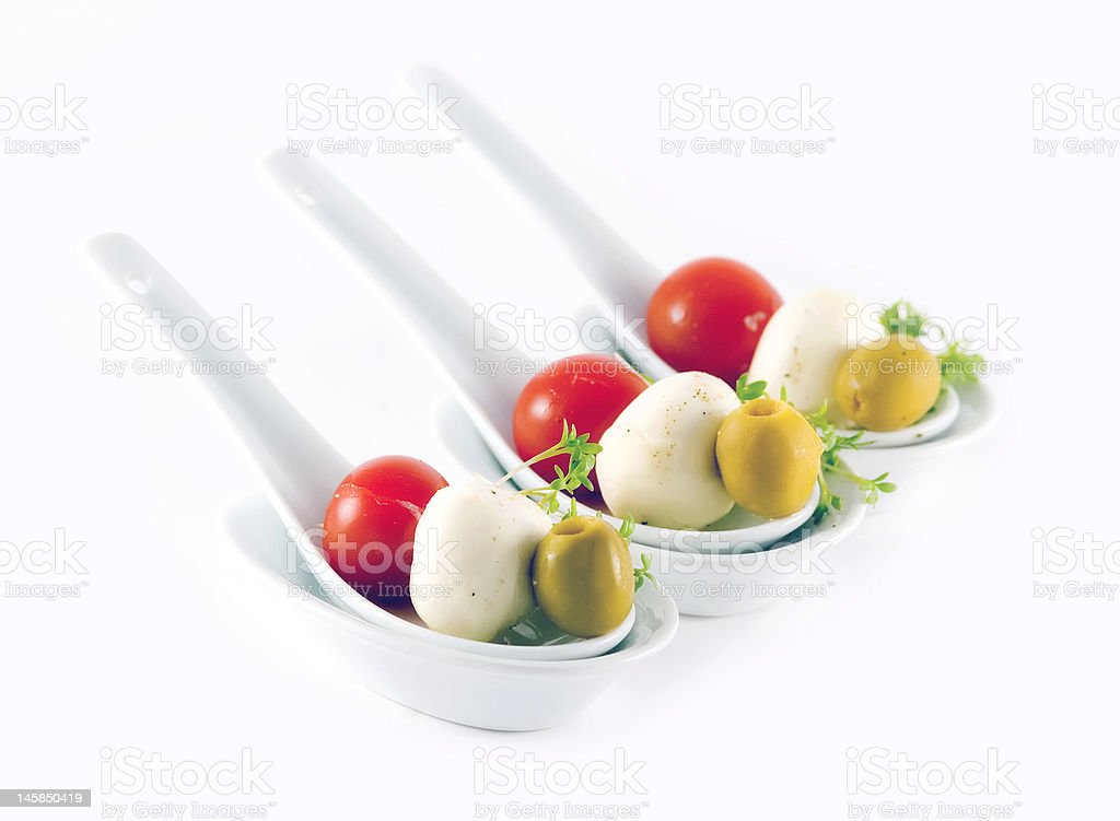 Individual spoons with vegetables and cheese royalty-free stock photo