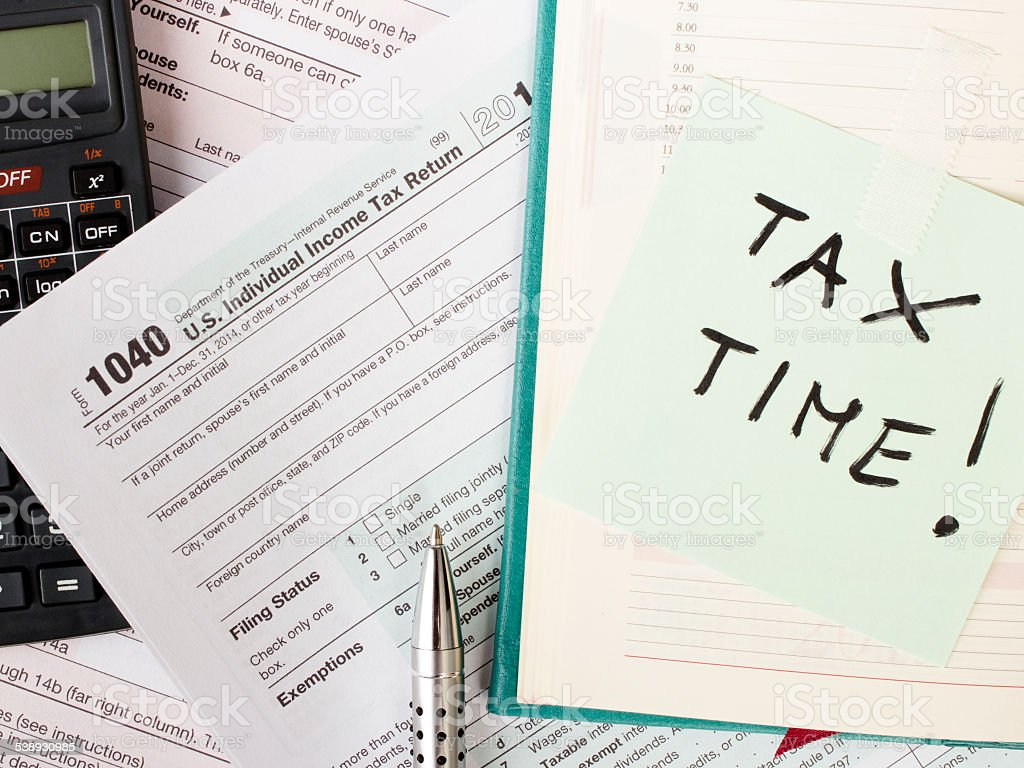U.S. Individual tax form 1040 with calculator and pen. stock photo