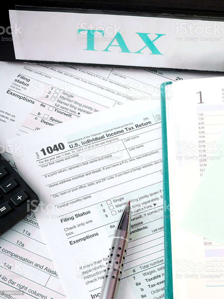 U.S. Individual tax form 1040 with calculator and pen stock photo
