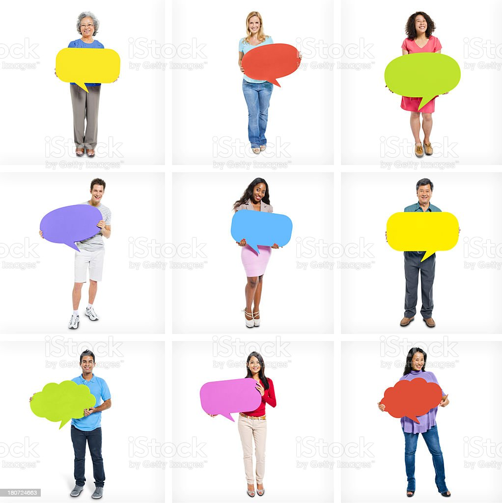 Individuals holding different colored word bubbles stock photo
