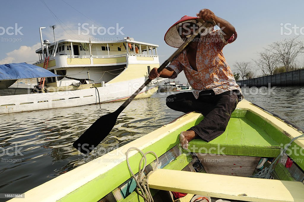 Indonesia boatman in Sunda Kelapa, Jakarta royalty-free stock photo
