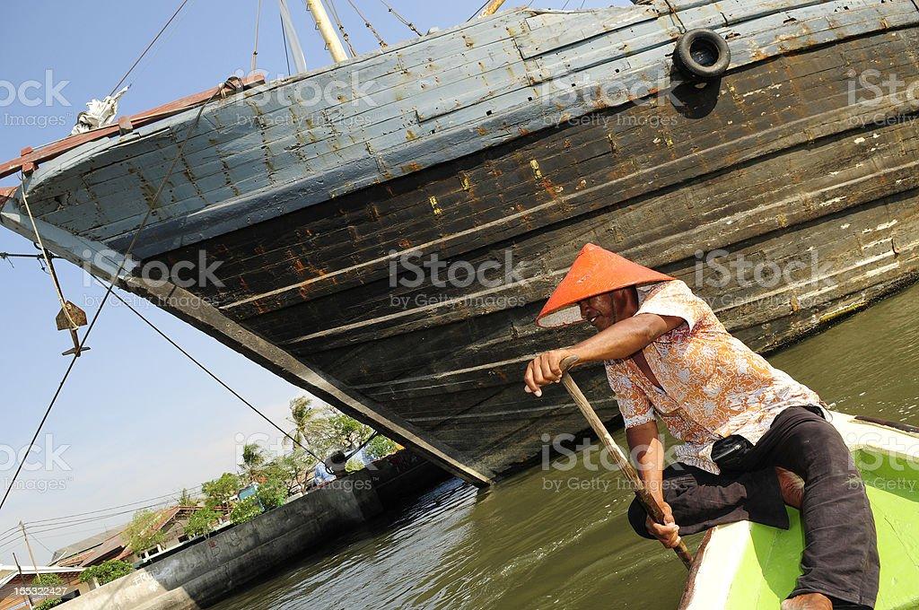 Indonesia boatman royalty-free stock photo