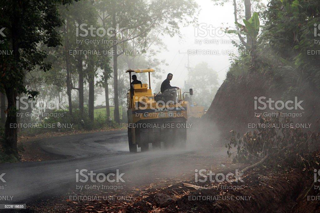 Indonesia: Road Crew Paving Highway stock photo