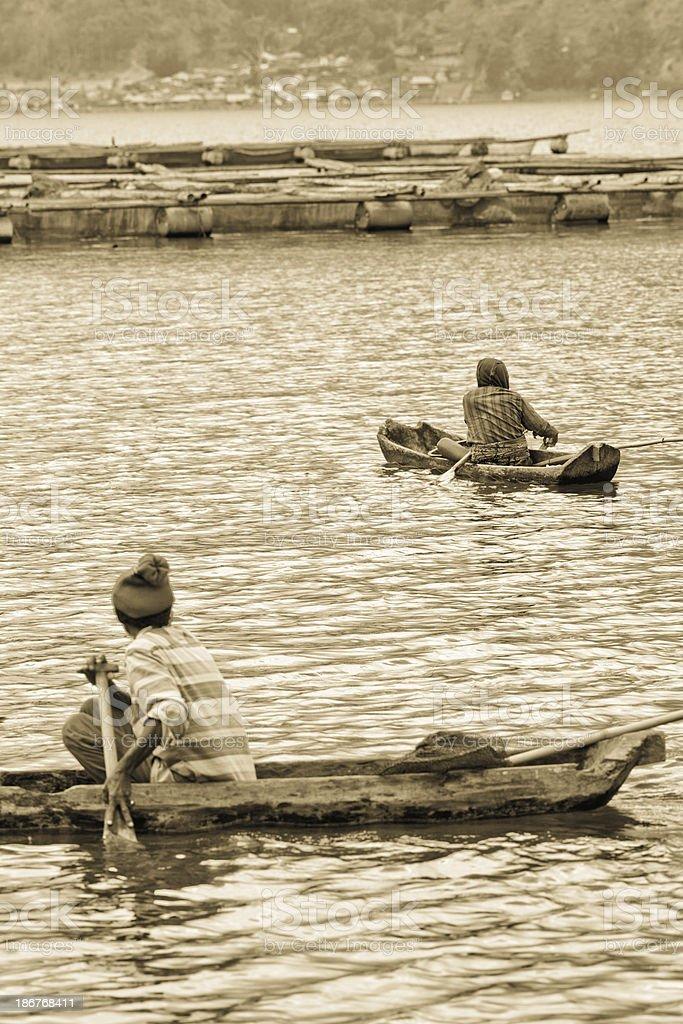 Indonesian fisherman fishing on a boat stock photo