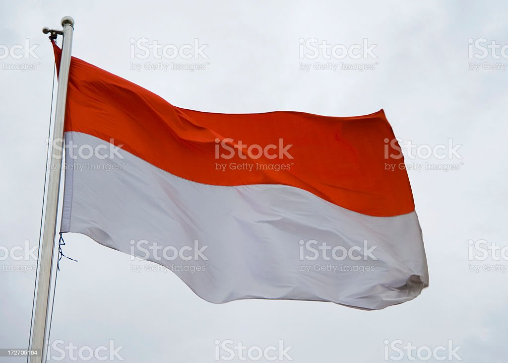 Indonesian flag waving on cloudy day stock photo