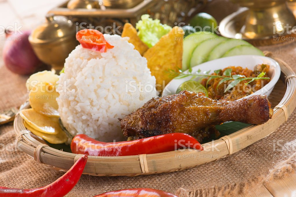 indonesian fried chicken rice on traditional background stock photo