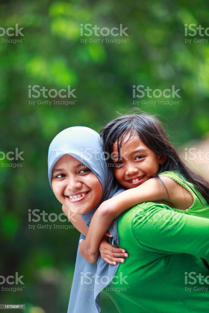 indonesian mother and her daughter royalty-free stock photo