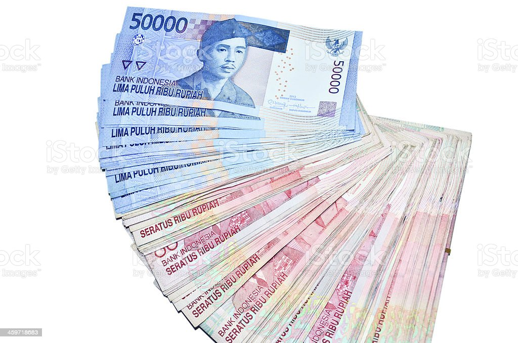 Indonesian Rupiah on a white background. stock photo