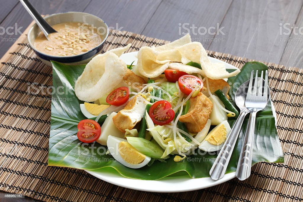 Indonesian salad with peanut sauce on a mat stock photo