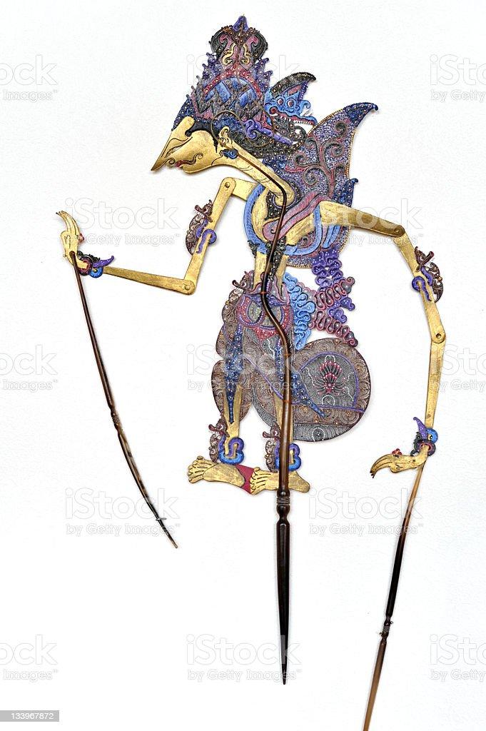 Indonesian traditional Wayang Kulit  puppet hanging on white wall stock photo