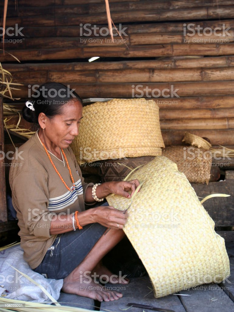 Indonesian Woman Basket Weaving royalty-free stock photo