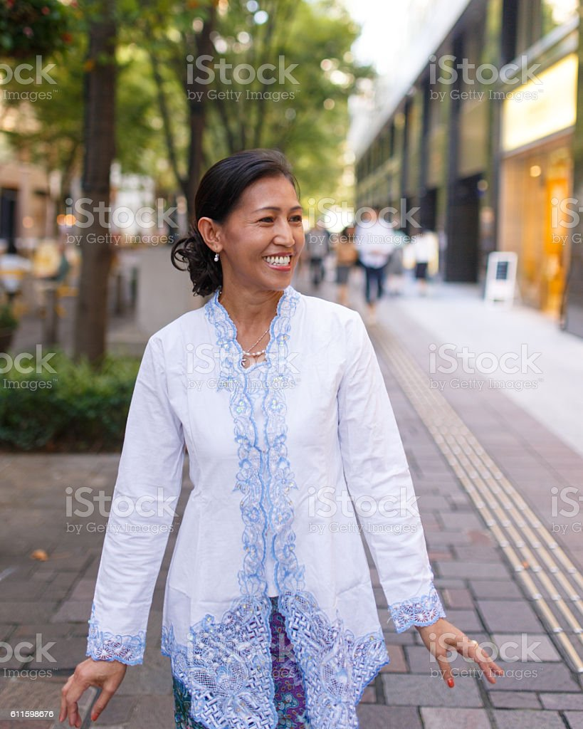 Indonesian woman walking in city of Tokyo stock photo