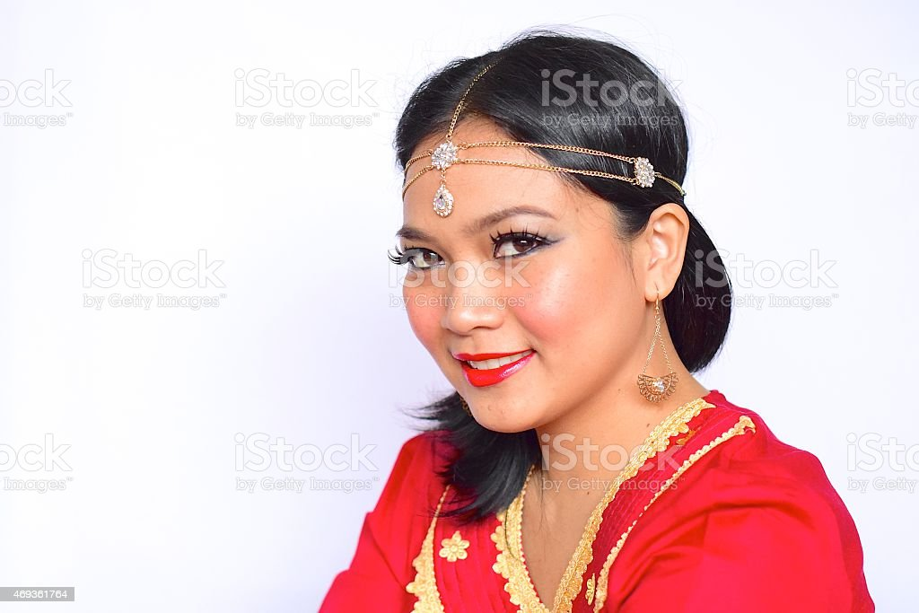 Indonesian woman with Indian jewelry and cloth stock photo