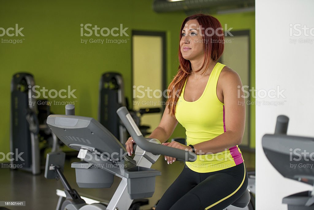 Indoor bicycle cycling in gym royalty-free stock photo