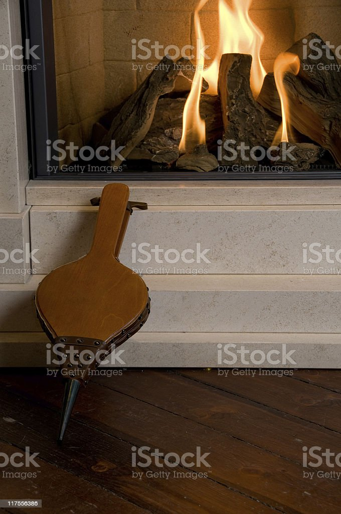 Indoor fireplace with burning wood stock photo