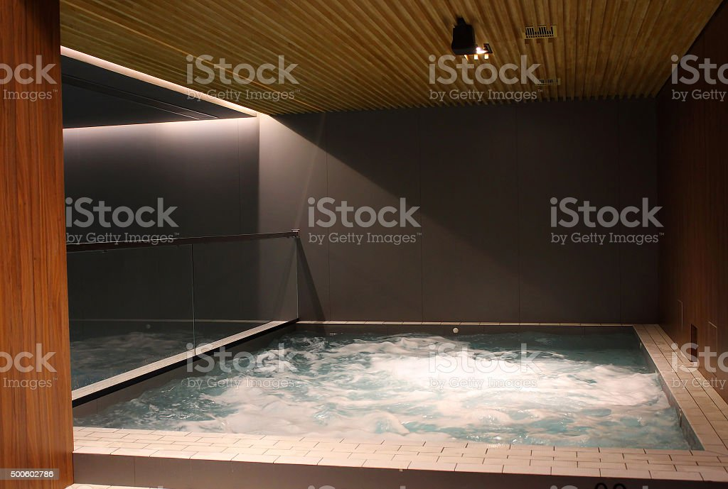 Indoor jacuzzi pool at the luxury spa resort stock photo