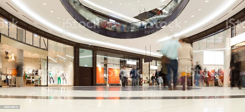 Indoor Image of Modern Shopping Mall with Stores and Shoppers stock photo
