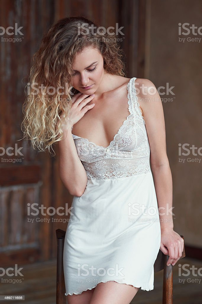 Indoor portrait of young blond sexy woman stock photo