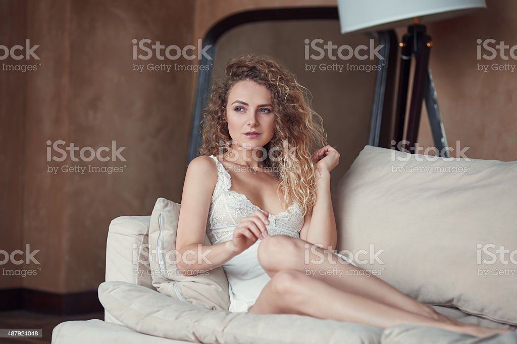 Indoor portrait of young sexy woman in sleepwear stock photo