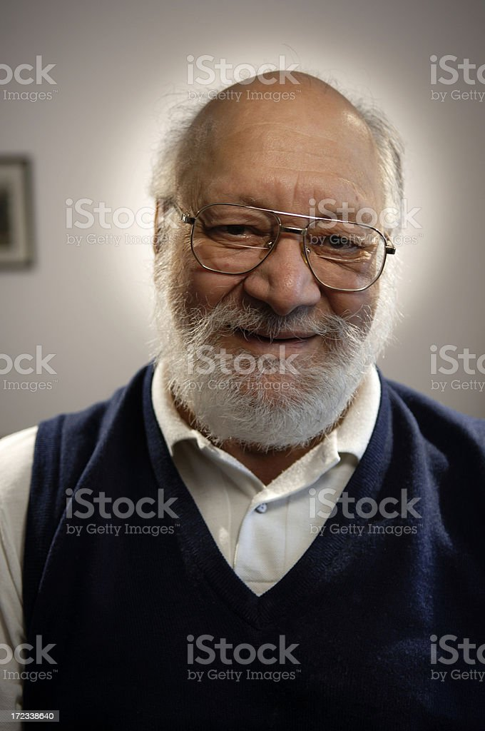 Indoor portrait senior bald man with glasses and beard royalty-free stock photo