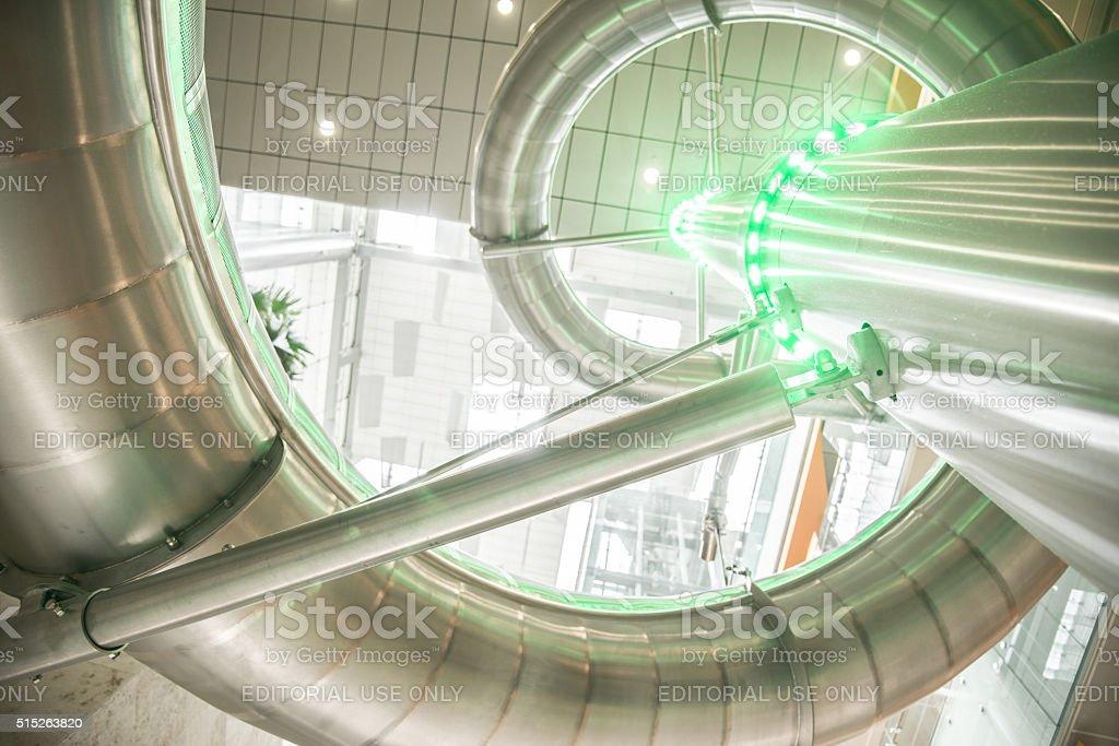 Indoor steel slide at Changi Airport stock photo