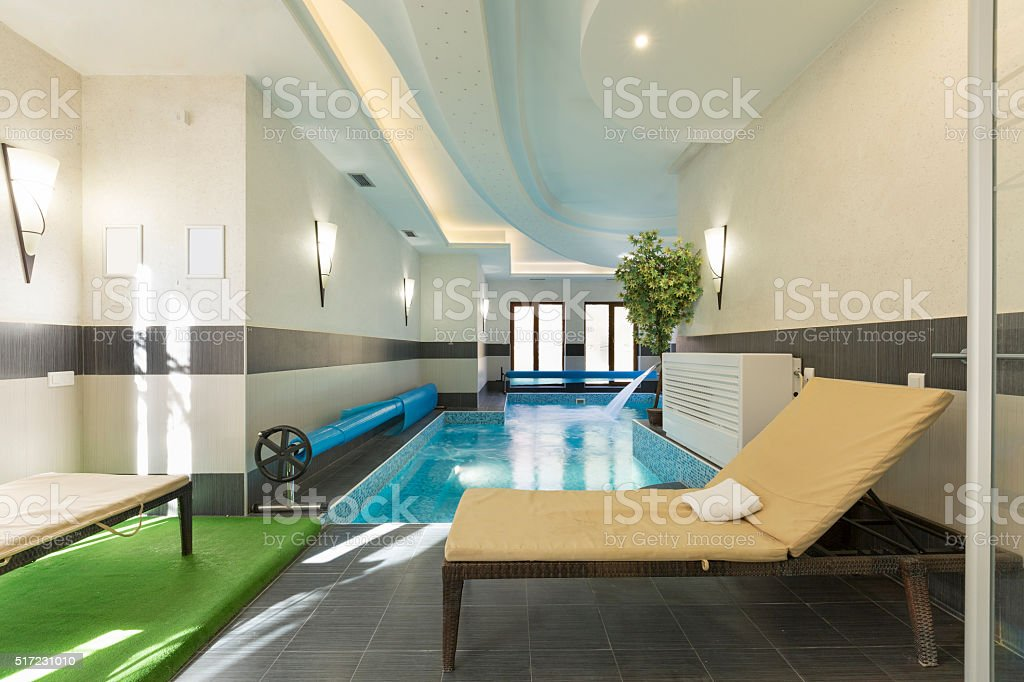 Indoor swimming pool at spa center stock photo