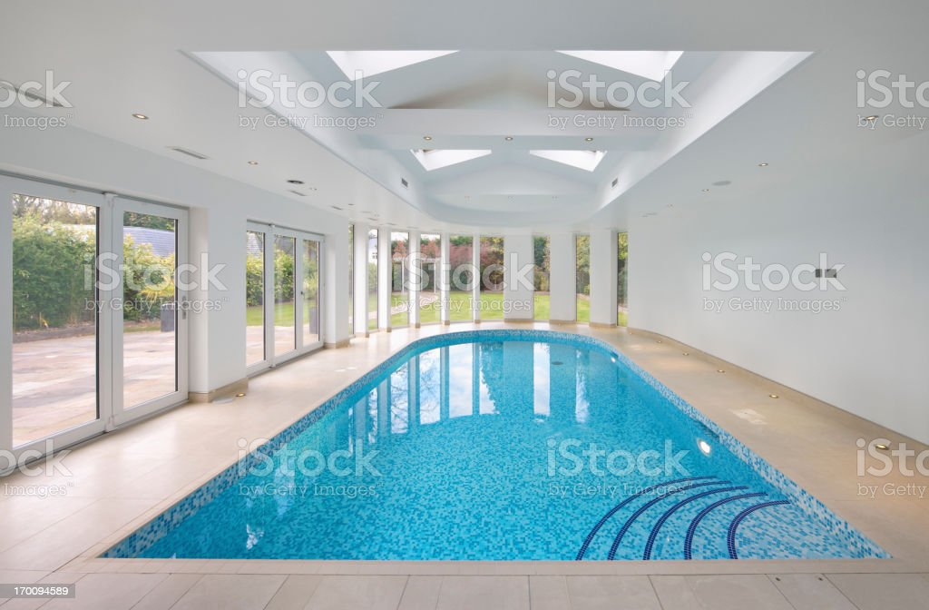 Indoor swimming pool in patio setting stock photo