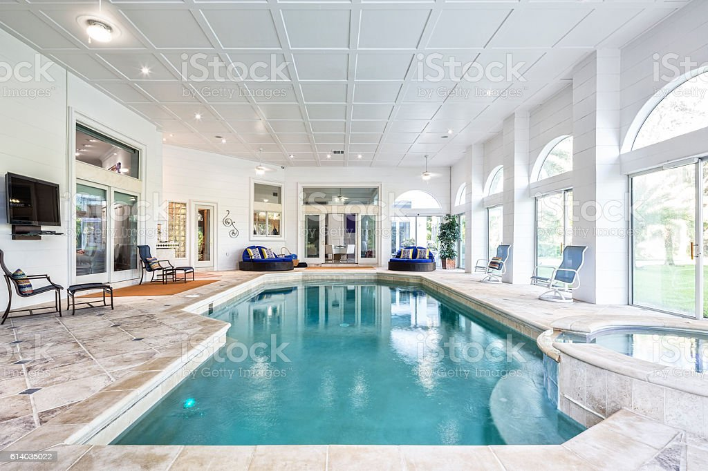 Indoor Swimming Pool with Spa at Estate Home stock photo