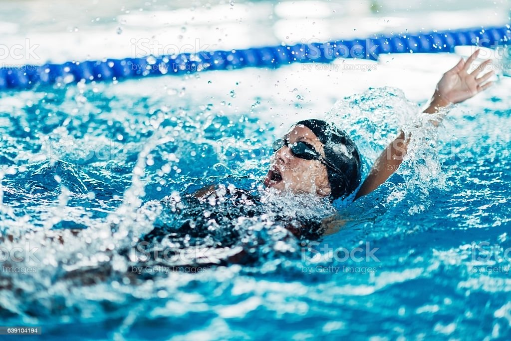 Indoor swimming race, backstroke stock photo