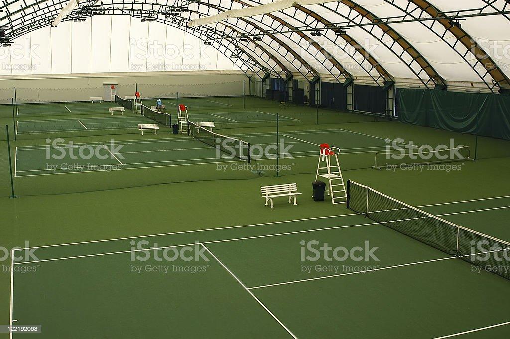 Indoor tennis court stock photo