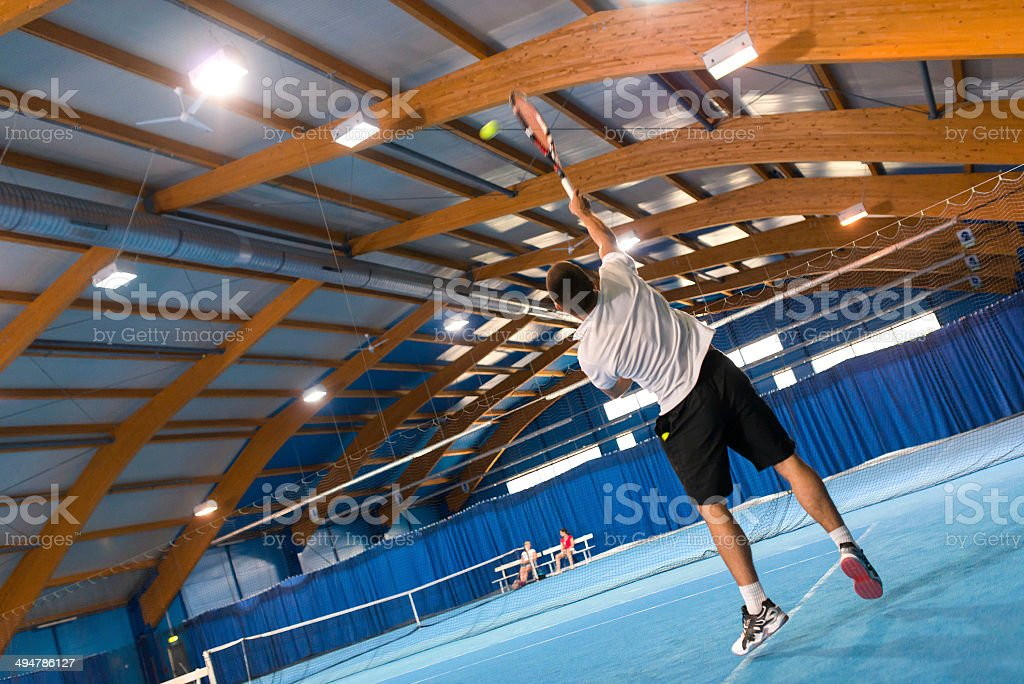 Indoor Tennis Serving Action stock photo