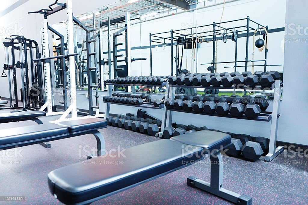 Indoor Weight Lifting Training Equipment in Interior Gymnasium Health Club stock photo