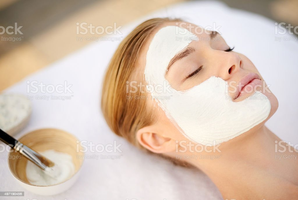 Indulging in a deep cleansing masque stock photo