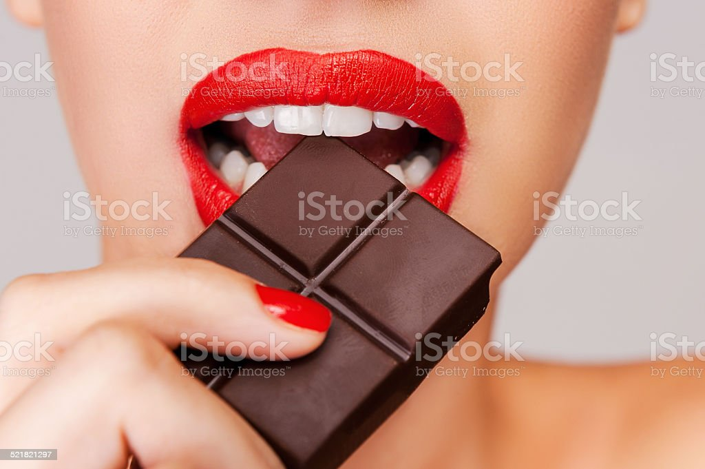 Indulging in a sweet affair with chocolate. stock photo