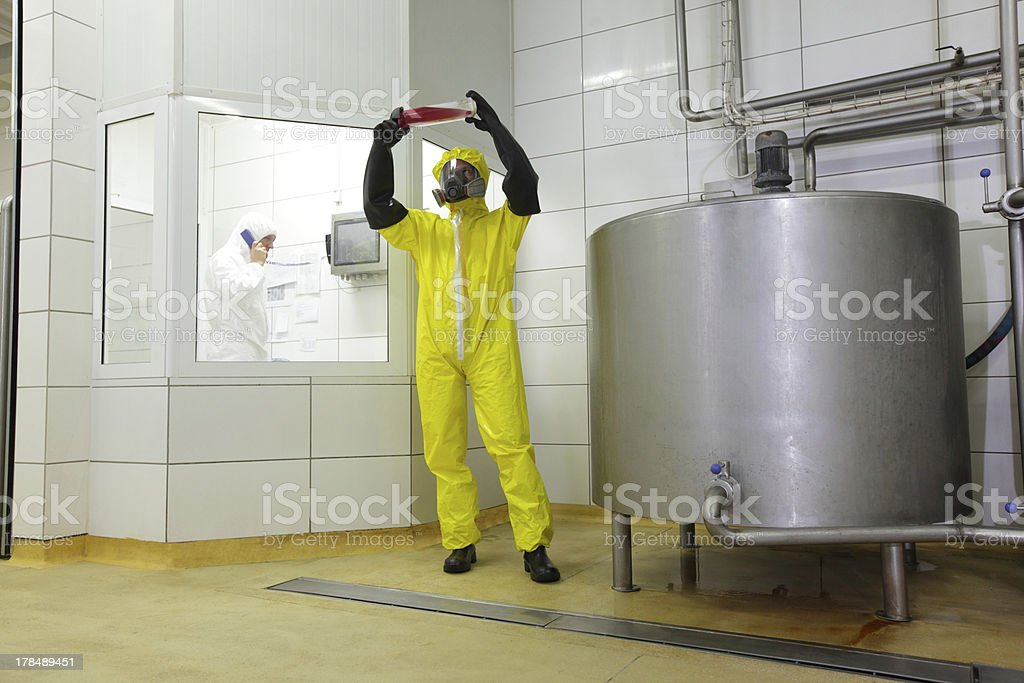 Industral professionals at work in plant royalty-free stock photo