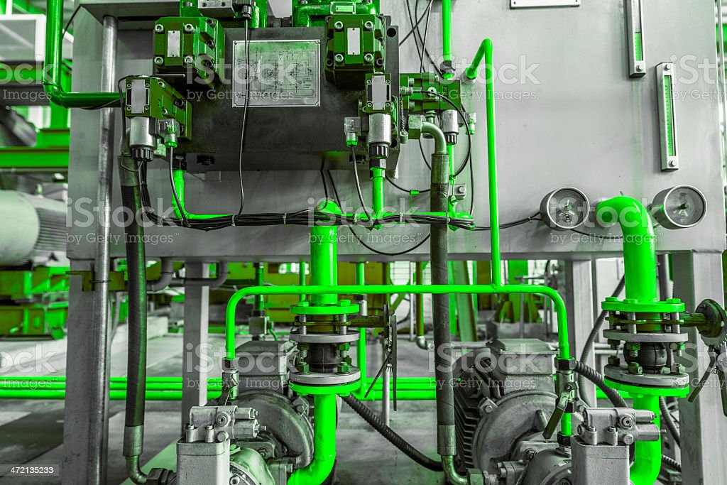 Industrial abstract---green tube of machine stock photo