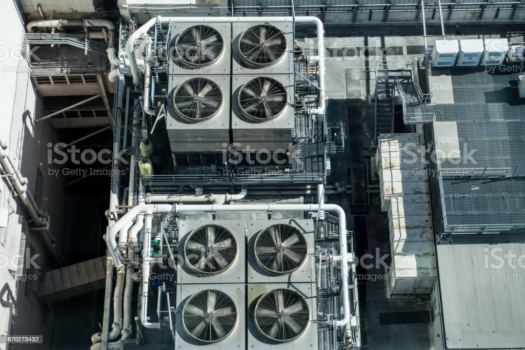 Industrial Air Conditioner Fans on Rooftop of Building stock photo