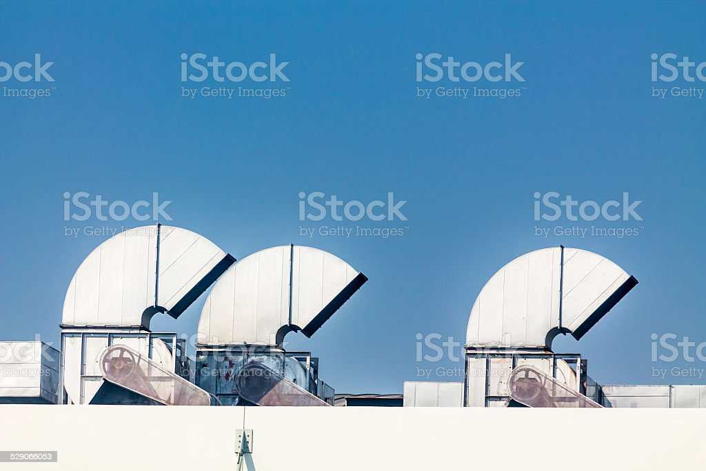 Industrial air conditioning and ventilation systems on a roof stock photo